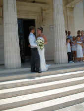 Standing on the steps of the registry office for a wedding in Paphos Cyprus