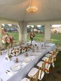Tables, chairs, tableware and decorations inside a small marquee for hire in Cyprus